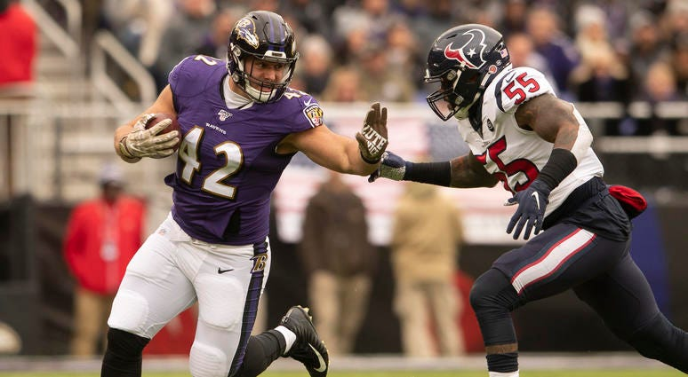 Patrick Ricard avoids a tackle in the Ravens win over Houston.