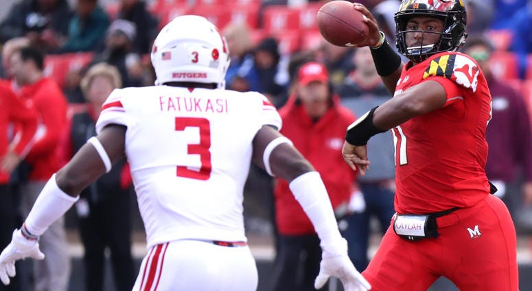 Oct 13, 2018; College Park, MD, USA; Maryland Terrapins quarterback Kasim Hill (11) throws against Rutgers Scarlet Knights linebacker Olakunle Fatukasi (3) at Capital One Field at Maryland Stadium. Mandatory Credit: Mitch Stringer-USA TODAY Sports