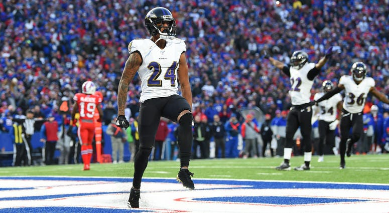 Baltimore Ravens cornerback Marcus Peters (24) reacts to his defensive play against the Buffalo Bills during the fourth quarter at New Era Field.