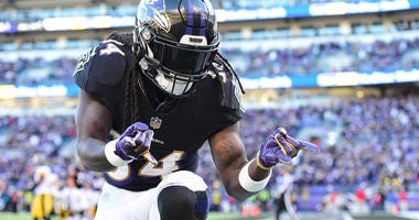Nov 4, 2018; Baltimore, MD, USA; Baltimore Ravens running back Alex Collins (34) reacts after scoring a third quarter touchdown against the Pittsburgh Steelers at M&T Bank Stadium.