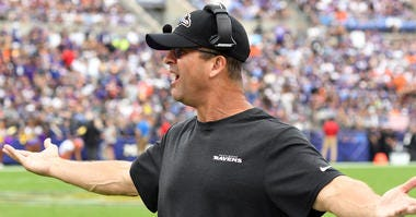 Head Coach John Harbaugh argues a call during the Ravens 40-25 loss in Week 4.