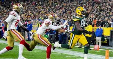 Oct 15, 2018; Green Bay, WI, USA; Green Bay Packers running back Ty Montgomery (88) scores a touchdown against San Francisco 49ers linebacker Fred Warner (48) in the first quarter at Lambeau Field. Mandatory Credit: Benny Sieu-USA TODAY Sports