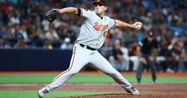 Orioles use Means' outstanding start, six-run ninth inning to power past Rays 9-6