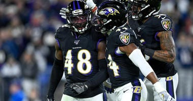 Baltimore Ravens inside linebacker Patrick Onwuasor (48) is congratulated by his teammates cornerback Marlon Humphrey (44) and defensive back Chuck Clark (36) after a sack during the first quarter against the New England Patriots at M&T Bank Stadium.