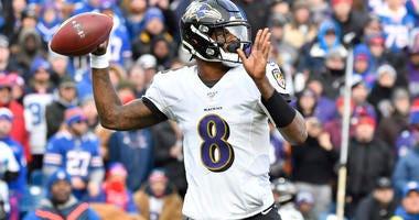 Lamar Jackson Throws A Pass Against The Bills