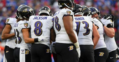 Baltimore Ravens offensive players huddle against the Buffalo Bills