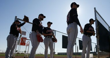 From left to right, Cleveland Indians pitchers Dominic Leone, Logan Allen, Kyle Dowdy, Shane Bieber, and Carlos Carrasco wait their turn for their pitching session during spring training baseball workouts for pitchers and catchers Thursday, Feb. 13, 2020,