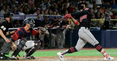 Cleveland Indians' infielder Francisco Lindor hits a home run against the Cincinnati Indians during the fifth inning of game one of a two-game MLB Series at Hiram Bithorn Stadium in San Juan, Puerto Rico, Tuesday, April 17, 2018.