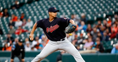 Cleveland Indians starting pitcher Carlos Carrasco throws to the Baltimore Orioles in the first inning of a baseball game, Monday, April 23, 2018, in Baltimore.