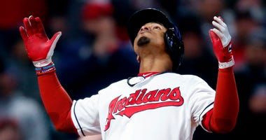 Cleveland Indians' Francisco Lindor celebrates after hitting a solo home run off Chicago Cubs starting pitcher Jon Lester during the sixth inning in a baseball game Wednesday, April 25, 2018, in Cleveland.