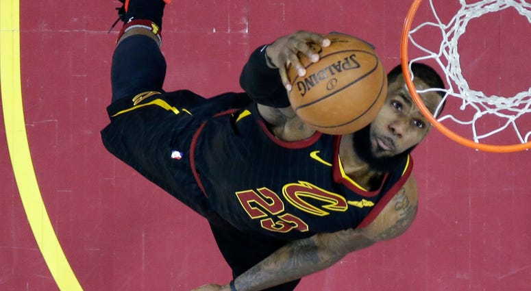 Cleveland Cavaliers' LeBron James (23) dunks against the Toronto Raptors during the first half of Game 3 of an NBA basketball second-round playoff series Saturday, May 5, 2018, in Cleveland.
