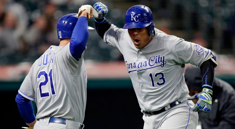 Kansas City Royals' Salvador Perez, right, and Lucas Duda celebrate after Perez hit a two-run home run off Cleveland Indians relief pitcher Andrew Miller during the seventh inning of a baseball game Friday, May 11, 2018, in Cleveland.