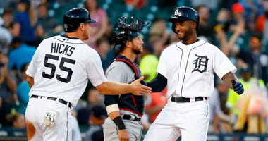 Detroit Tigers' Niko Goodrum, right, celebrates his two-run home run with teammate John Hicks (55) in the fourth inning of a baseball game against the Cleveland Indians in Detroit, Monday, May 14, 2018.