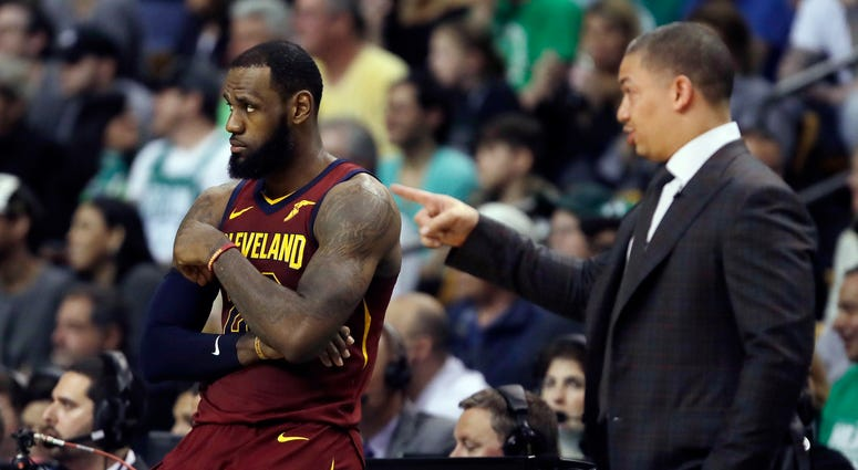 avaliers coach Tyronn Lue, right, speaks to LeBron James during a timeout in the first half in Game 2 of the team's NBA basketball Eastern Conference finals against the Boston Celtics