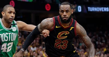 Cleveland Cavaliers' LeBron James (23) drives past Boston Celtics' Al Horford (42), from Dominican Republic, in the first half of Game 4 of the NBA basketball Eastern Conference finals, Monday, May 21, 2018, in Cleveland.