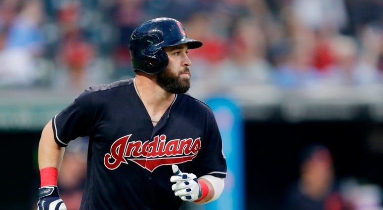 Cleveland Indians' Jason Kipnis watches his solo home run off Chicago White Sox relief pitcher Chris Beck during the eighth inning of a baseball game Tuesday, May 29, 2018, in Cleveland.