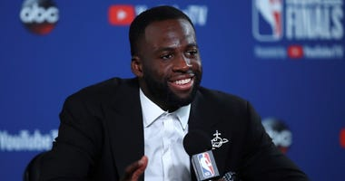 Golden State Warriors forward Draymond Green speaks at a news conference after Game 1 of basketball's NBA Finals against the Cleveland Cavaliers in Oakland, Calif., Thursday, May 31, 2018. The Warriors won 124-114 in overtime