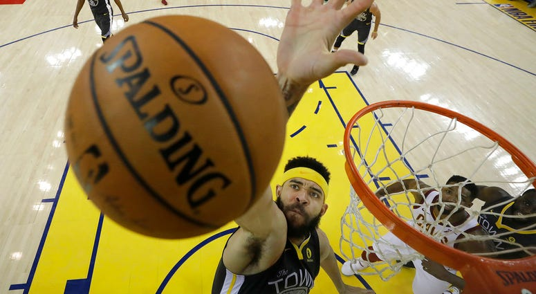 Golden State Warriors center JaVale McGee (1) reaches for a rebound during the first half of Game 2 of basketball's NBA Finals between the Warriors and the Cleveland Cavaliers in Oakland, Calif., Sunday, June 3, 2018.