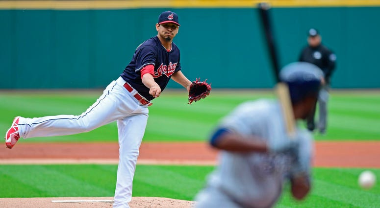 Cleveland Indians starting pitcher Carlos Carrasco delivers to Milwaukee Brewers' Jonathan Cain in the first inning of a baseball game, Wednesday, June 6, 2018, in Cleveland.