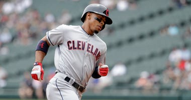 Cleveland Indians' Francisco Lindor heads for home after hitting a home run off Chicago White Sox starting pitcher Carlos Rodon during the first inning of a baseball game Thursday, June 14, 2018, in Chicago.