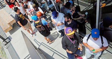 os Angeles Lakers fans wait in line around noon for promised free pizza that will be handed out between 2 and 5 p.m. at Blaze Pizza, a restaurant chain NBA basketball player LeBron James was an original investor in, Tuesday, July 10, 2018, in Culver City.