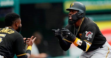 Pittsburgh Pirates' Josh Harrison, right, celebrates with Gregory Polanco after hitting a three-run home run in the second inning of a baseball game against the Cleveland Indians, Monday, July 23, 2018, in Cleveland. Josh Bell and David Freese scored.