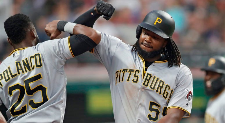 Pittsburgh Pirates' Josh Bell, right, is congratulated by Gregory Polanco after Bell hit a two-run home run in the fifth inning of a baseball game, Tuesday, July 24, 2018, in Cleveland.
