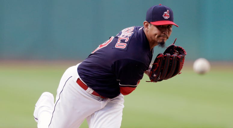 Cleveland Indians starting pitcher Carlos Carrasco delivers in the first inning of a baseball game against the Minnesota Twins, Tuesday, Aug. 28, 2018, in Cleveland.