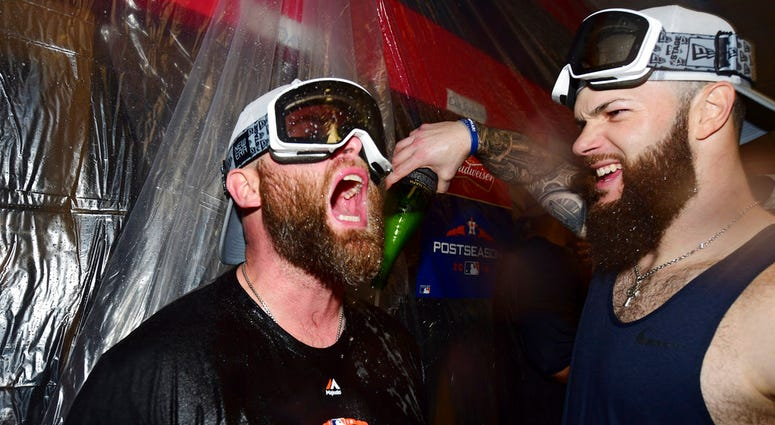 Houston Astros starting pitcher Dallas Keuchel, right, celebrates with Brian McCann after the Astros defeated the Cleveland Indians 11-3 in Game 3 of a baseball American League Division Series, Monday, Oct. 8, 2018, in Cleveland.
