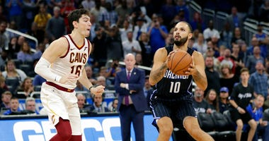 Orlando Magic's Evan Fournier (10) prepares to go up for a shot just before the buzzer as Cleveland Cavaliers' Cedi Osman, left, tries to defend as Orlando defeated Cleveland in an NBA basketball game, Monday, Nov. 5, 2018, in Orlando, Fla. (AP Photo/John