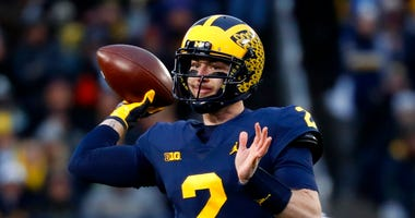 Michigan quarterback Shea Patterson (2) throws against Indiana in the first half of an NCAA college football game against Indiana in Ann Arbor, Mich., Saturday, Nov. 17, 2018. (AP Photo/Paul Sancya)