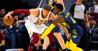 Cleveland Cavaliers forward Kyle Korver (26) keeps the ball away from Indiana Pacers guard Victor Oladipo (4) during the third quarter of a preseason NBA basketball game, in Cleveland. A person familiar with the deal said Wednesday, Nov. 28, 2018, the Cle