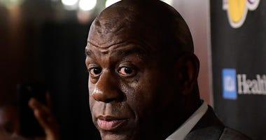 Magic Johnson resigns