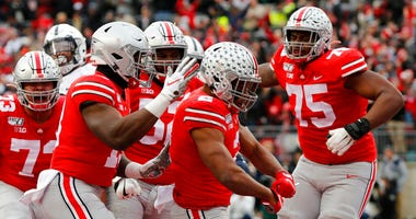 Ohio State running back J.K. Dobbins (2) celebrates his touchdown against Penn State with teammates during the first half of an NCAA college football game Saturday, Nov. 23, 2019, in Columbus, Ohio. (AP Photo/Jay LaPrete)