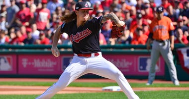 In this Oct. 8, 2018, file photo, Cleveland Indians starting pitcher Mike Clevinger delivers in the first inning during Game 3 of a baseball American League Division Series against the Houston Astros in Cleveland.