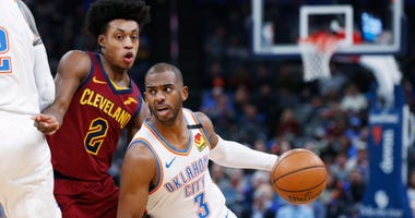 Thunder guard Chris Paul (3) drives around Cleveland Cavaliers guard Collin Sexton (2) during the first half of an NBA basketball game Wednesday, Feb. 5, 2020, in Oklahoma City. (AP Photo/Sue Ogrocki)
