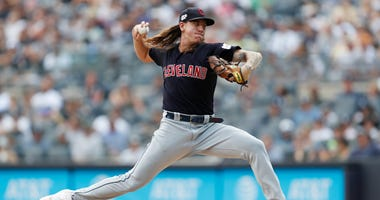 In this Aug. 18, 2019, file photo, Cleveland Indians' starting pitcher Mike Clevinger winds up during the first inning of a baseball game against the New York Yankees, in New York.