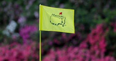 FILE - In this April 11, 2019, file photo, the flag on the 13th hole blows in the wind during the first round for the Masters golf tournament in Augusta, Ga. Augusta National decided Friday, March 13, 2020, to postpone the Masters because of the spread of