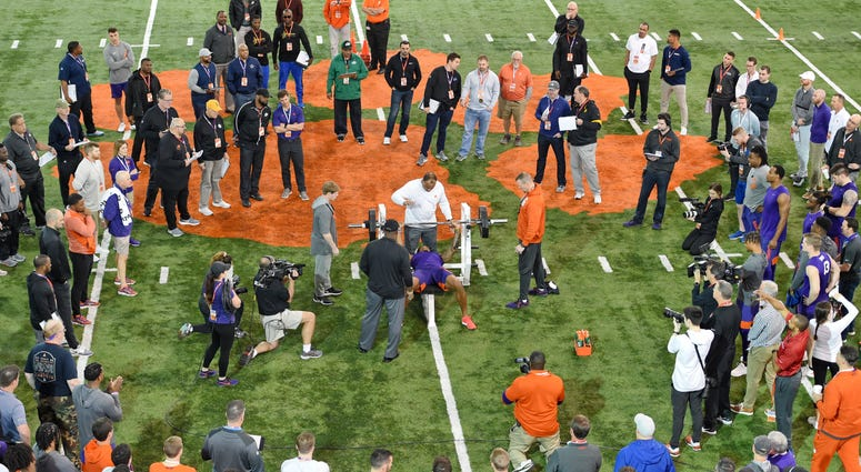 FILE - In this March 12, 2020, file photo, Clemson football player Tee Higgins lifts weights during NFL Pro Day in Clemson, S.C. Scouts, front-office executives and even coaches find themselves coping with a whole new process with Americans hunkering down