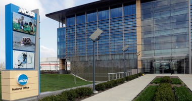 FILE - In this is an April 25, 2018, file photo, NCAA headquarters in Indianapolis is viewed. College sports programs are already being cut and more are likely on the chopping block. The coronavirus pandemic has triggered fears of an economic meltdown on