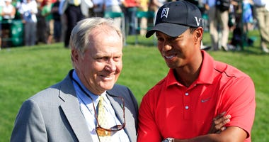 In this June 3, 2012 file photo, Jack Nicklaus chats with Tiger Woods after the latter won the Memorial tournament in Dublin, Ohio.