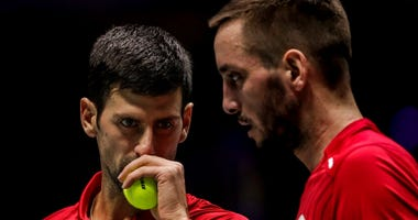 FILE - In this Nov. 22, 2019, file photo, Serbia's Novak Djokovic, left, and teammate Viktor Troicki play against Russia's Karen Khachanov and Andrey Rublev during the Davis Cup quarterfinal doubles match in Madrid, Spain. Another tennis player has tested
