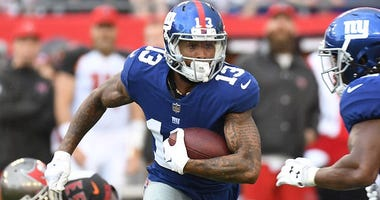 Oct 1, 2017; Tampa, FL, USA; New York Giants wide receiver Odell Beckham Jr. (13) runs with the ball in the first half against the Tampa Bay Buccaneers at Raymond James Stadium. Mandatory Credit: Jonathan Dyer-USA TODAY Sports