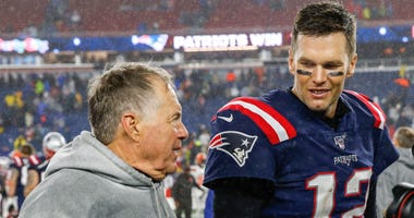 New England Patriots head coach Bill Belichick (left) and former quarterback Tom Brady (right)