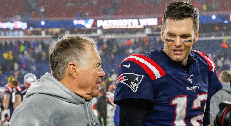 New England Patriots head coach Bill Belichick (left) and former quarterback Tom Brady (right)