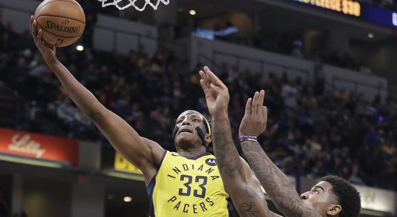 Indiana Pacers Myles Turner goes up to shoot against Cleveland Cavaliers Marquese Chriss during the first half of an NBA basketball game Saturday Feb 9 2019 in Indianapolis.