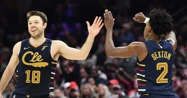 Cavaliers guard Matthew Dellavadova and Collin Sexton