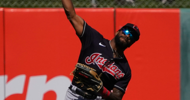 Mar 9, 2020; Tempe, Arizona, USA; Cleveland Indians center fielder Delino DeShields (0) makes the play against the Los Angeles Angels during a spring training game at Tempe Diablo Stadium. Mandatory Credit: Rick Scuteri-USA TODAY Sports