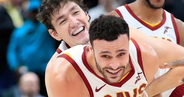 DECEMBER 18: Larry Nance Jr. #22 of the Cleveland Cavaliers celebrates with Cedi Osman #16 after making the game winning basket in the 92-91 win against the Indiana Pacers at Bankers Life Fieldhouse on December 18, 2018 in Indianapolis, Indiana. (Photo by