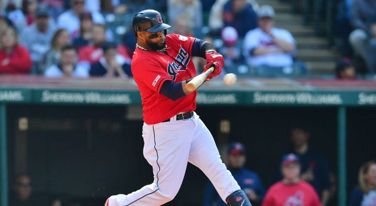 CLEVELAND, OHIO - APRIL 06: Carlos Santana #41 of the Cleveland Indians hits an RBI single during the first inning against the Toronto Blue Jays at Progressive Field on April 06, 2019 in Cleveland, Ohio. (Photo by Jason Miller/Getty Images)